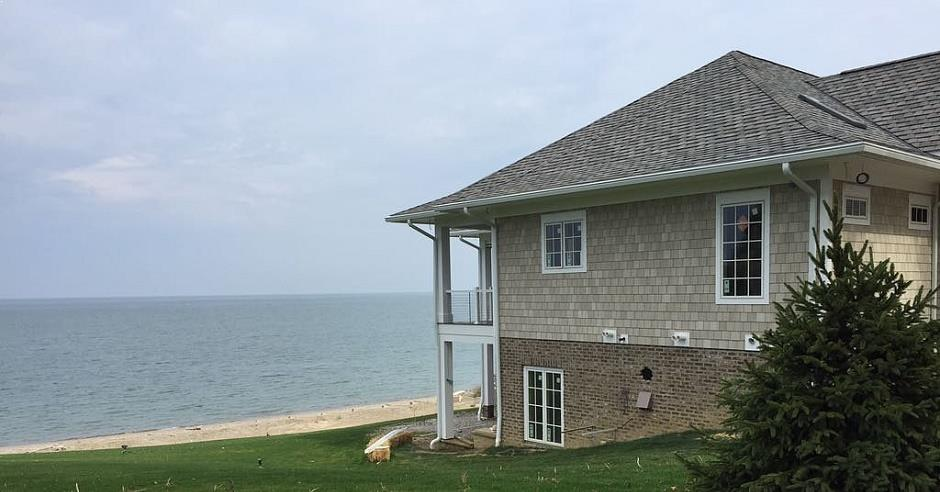 Corner of a house with new K-Guard leaf free gutters, showing Lake Erie in the background