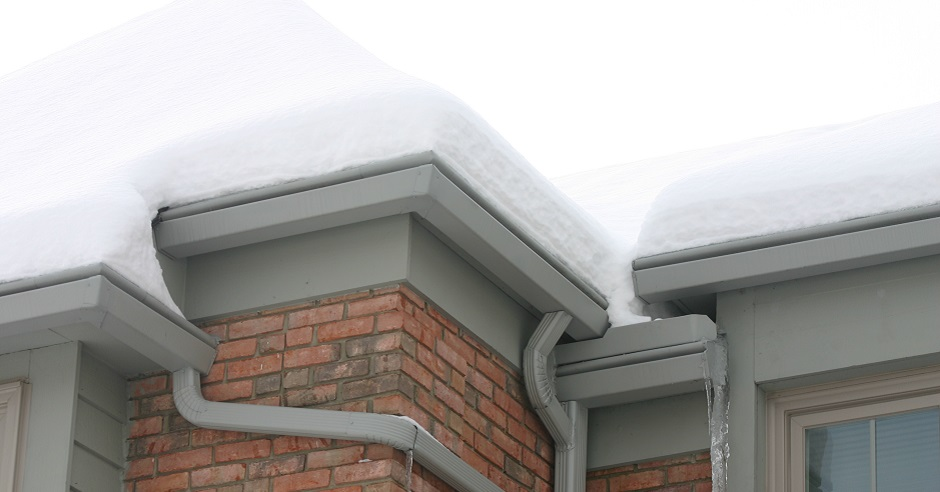 Close-up view of a roof with snow sitting on top
