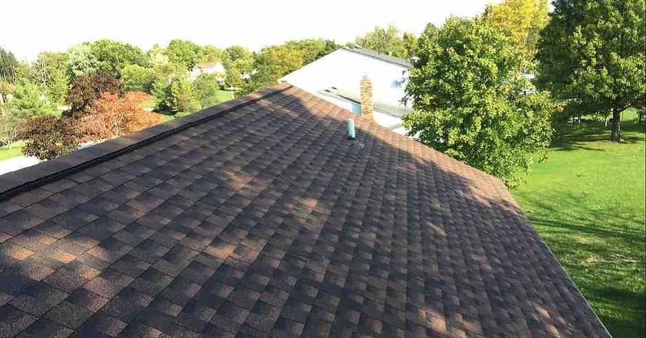 Overhead view of a newly installed asphalt shingle roof